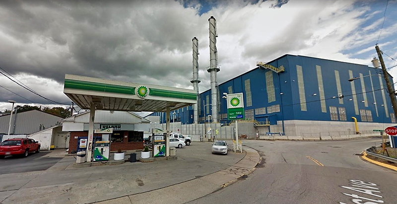 BP gas station with factory in back ground